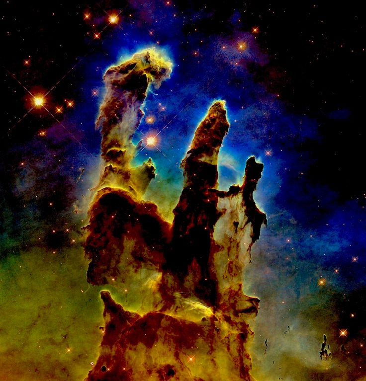 Pillars of Creation: interstellar gas and dust in the Eagle Nebula, some 6,500-7,000 light years from Earth where stars are born